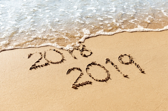 New Year 2019 replace 2018 on the sea beach summer concept